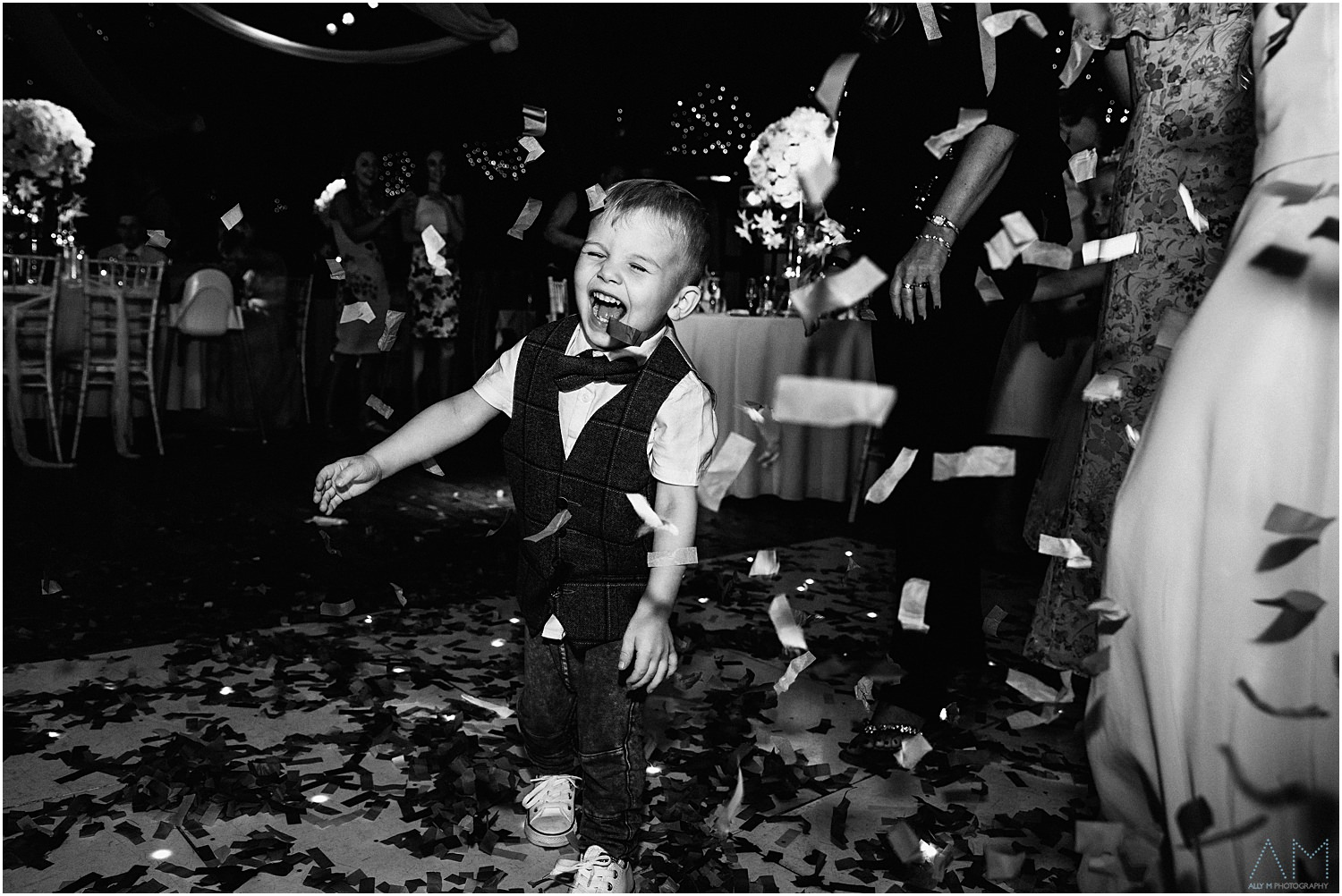 Little boy playing in the confetti
