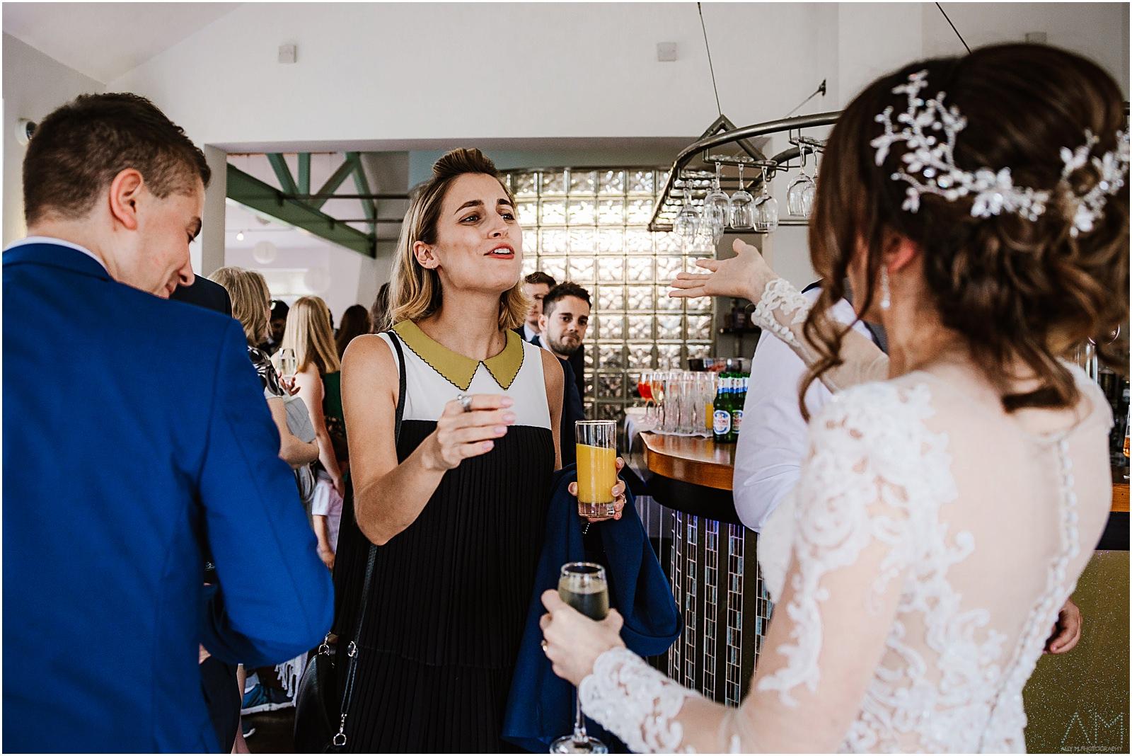 Wedding guest congratulating the bride