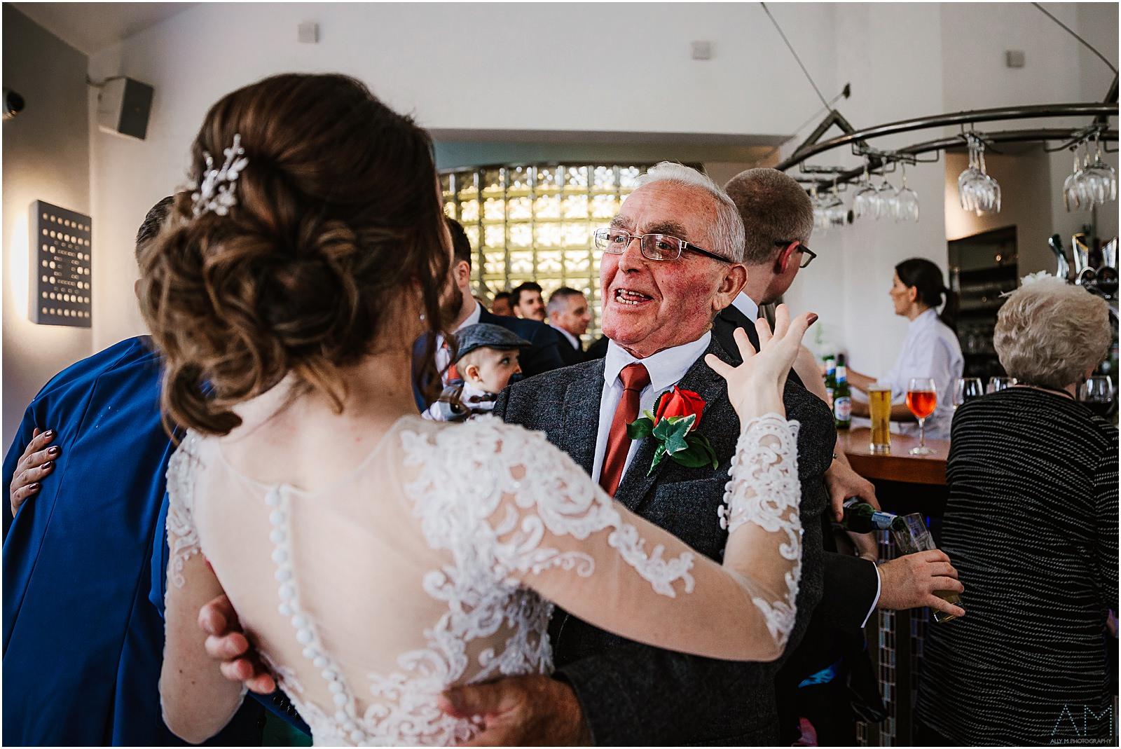 Grandad hugging his bride grandaughter