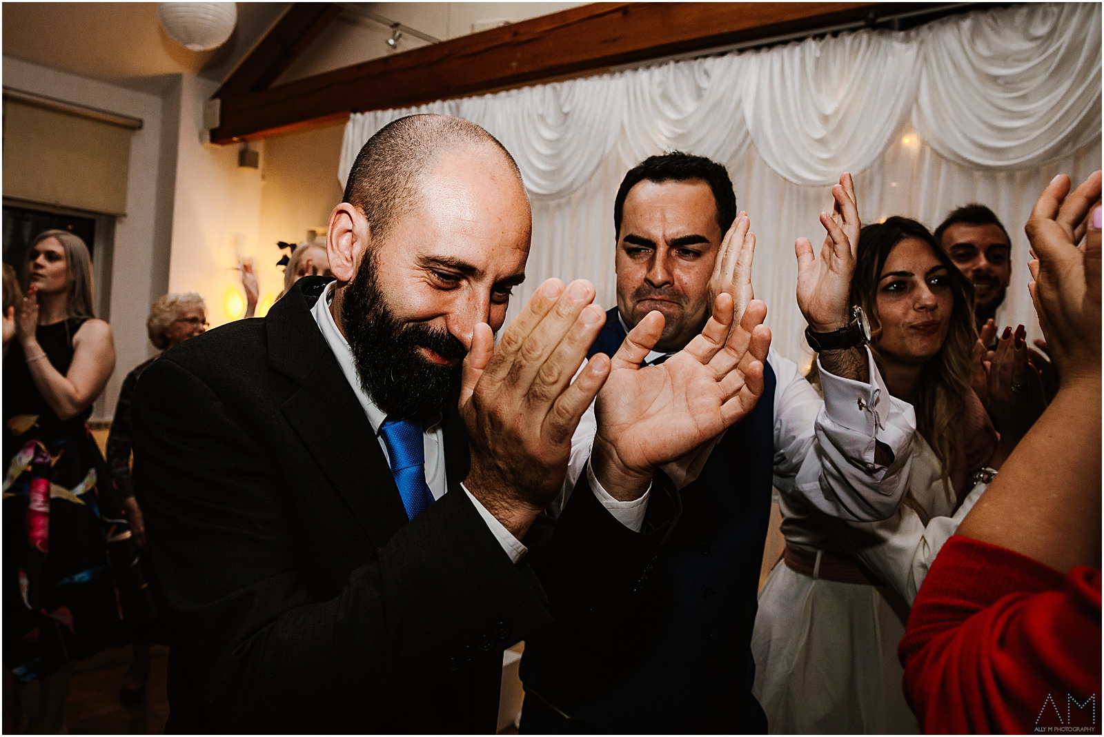 Wedding guest clapping on dance floor