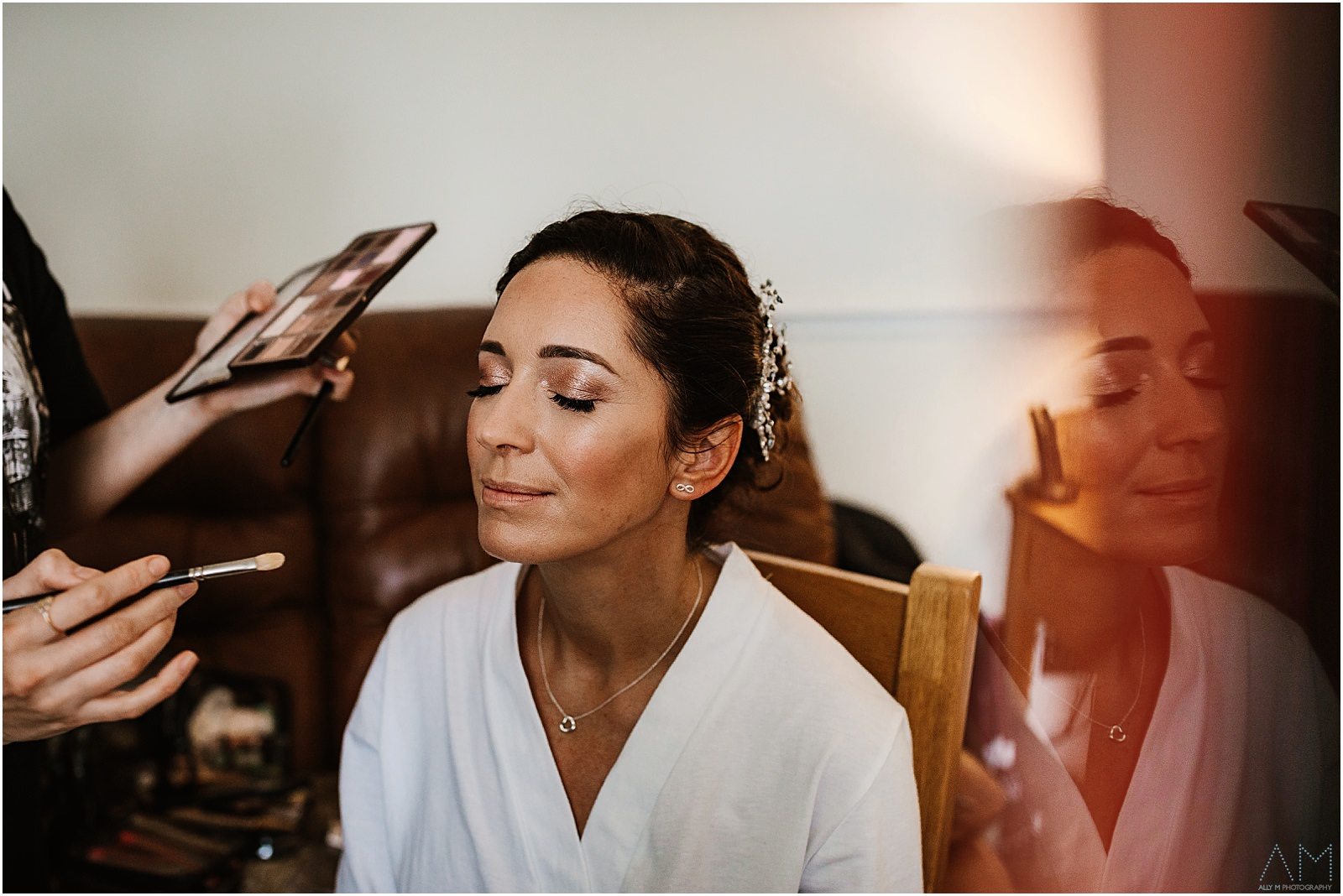 Bride getting make up applied