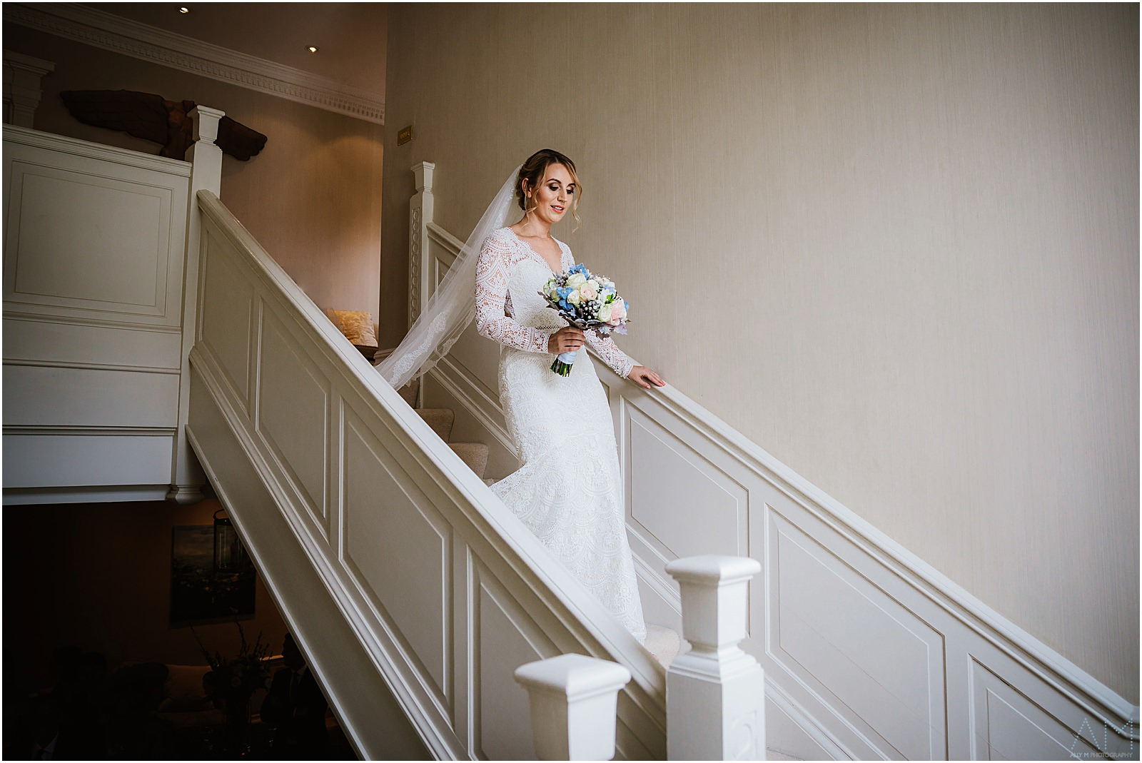 Bride walking down the stairs at Delamere Manor