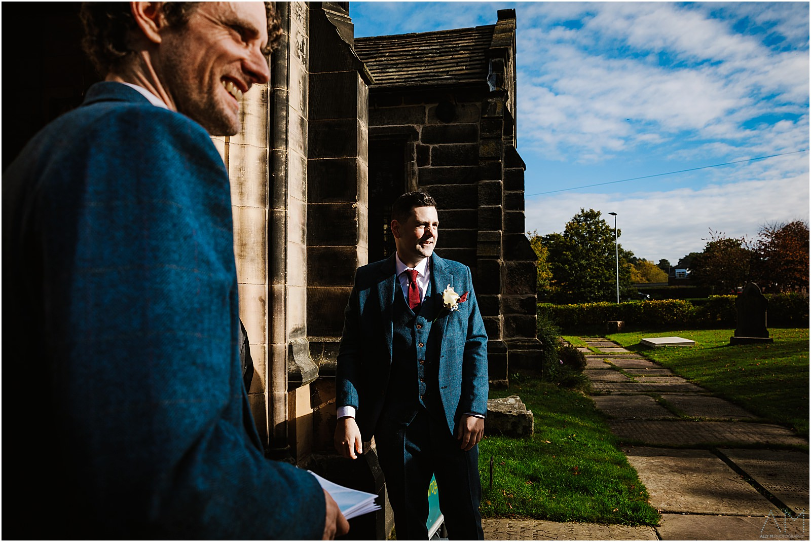 Groom and best man greeting guests