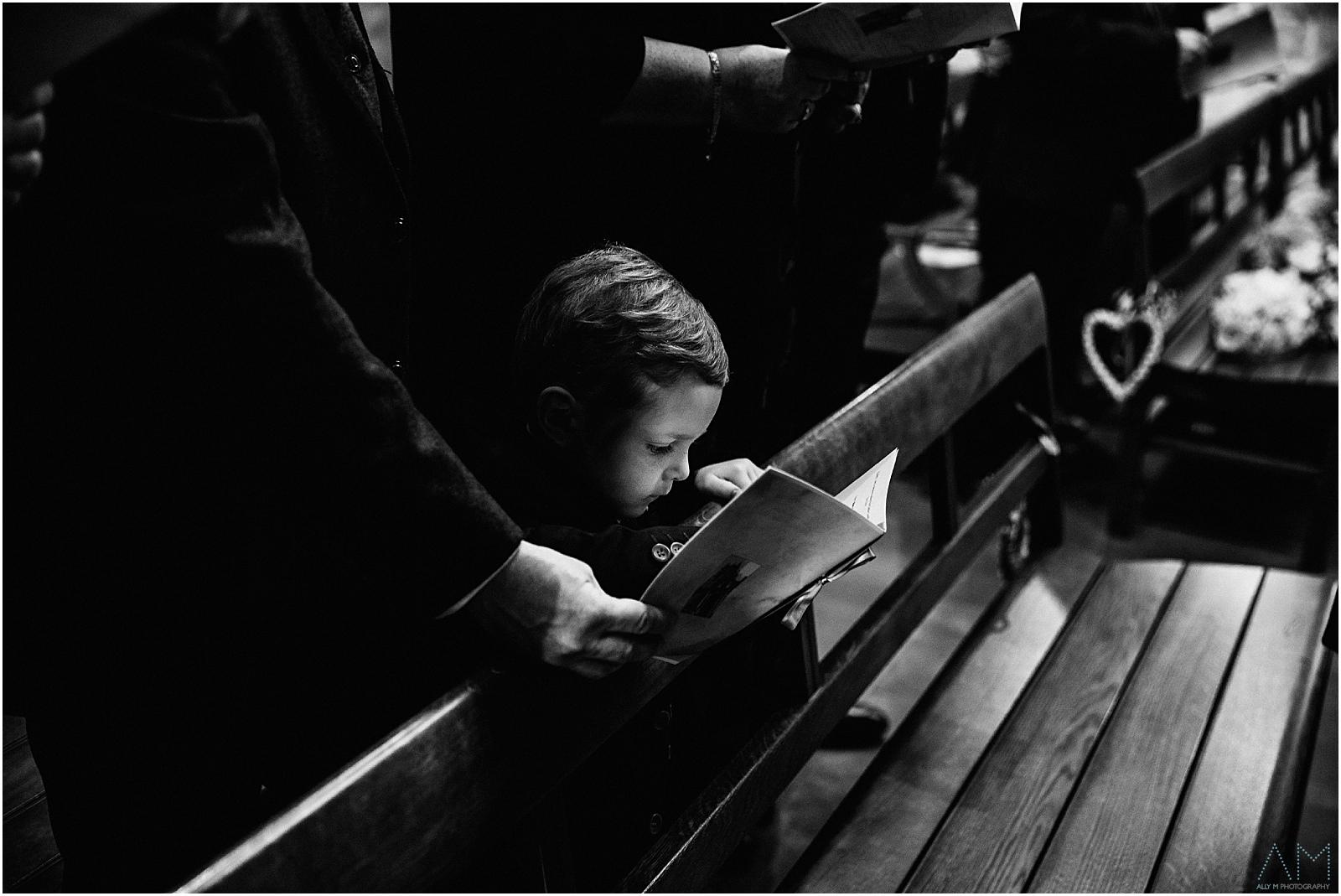Little boy singing in church