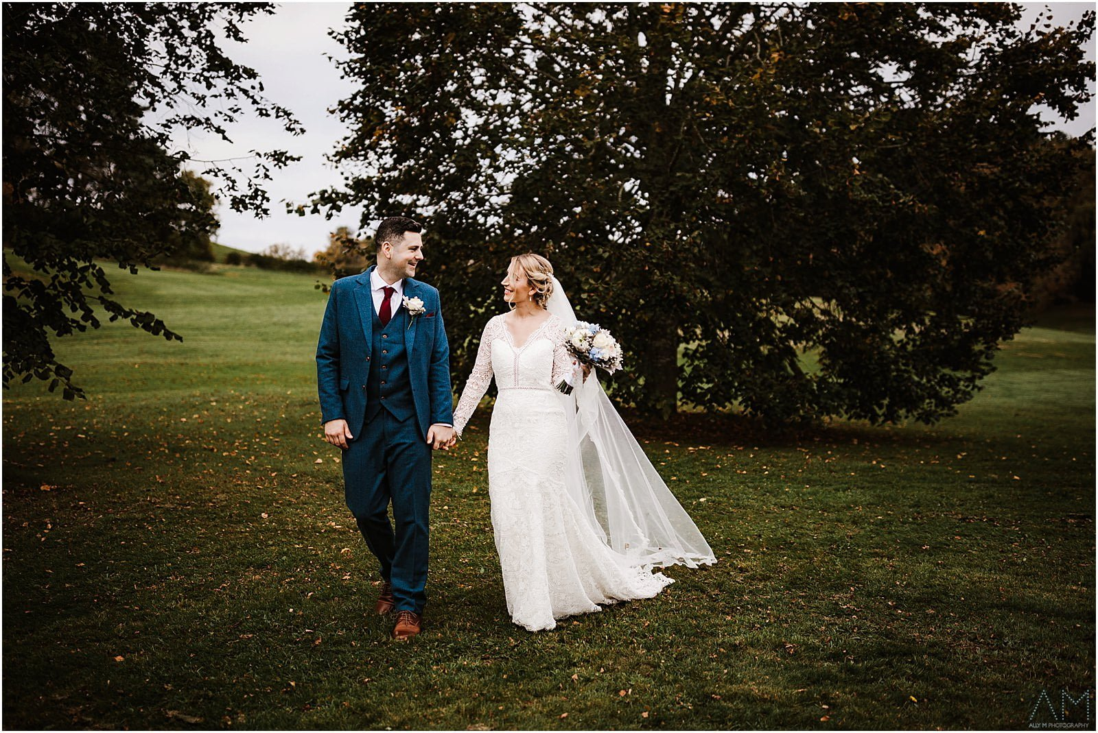 Bride and groom walking togther at Delamere Manor