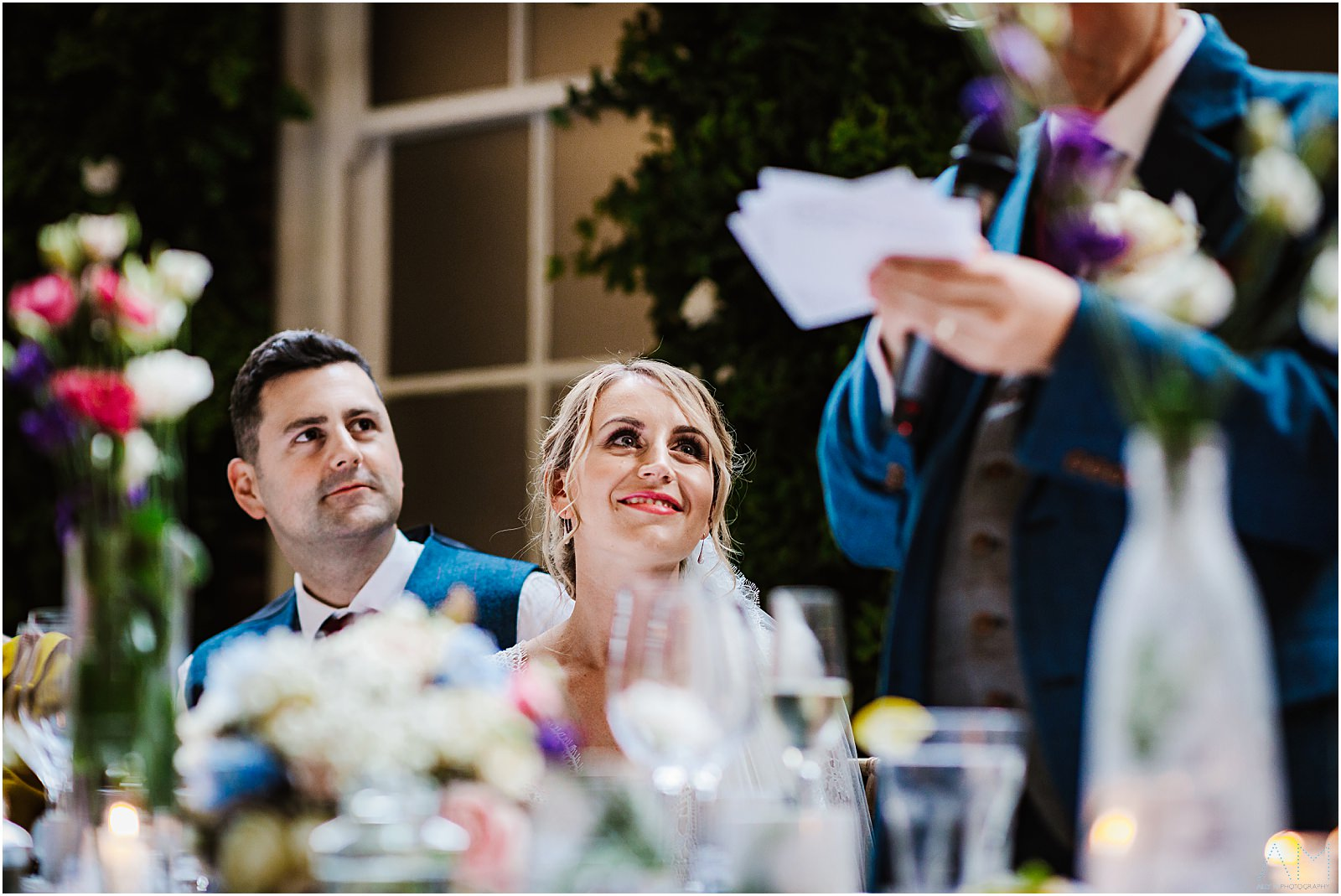 Bride and groom during the fathers speech