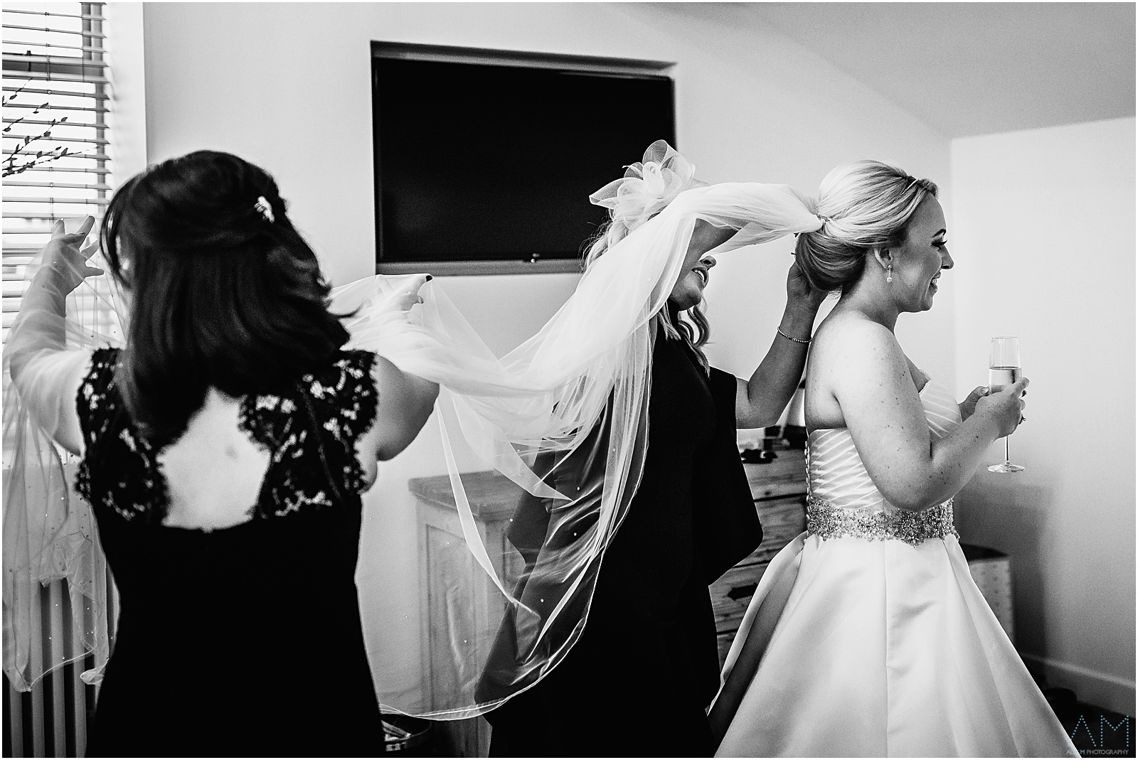 Bridesmaids helping the bride with her veil