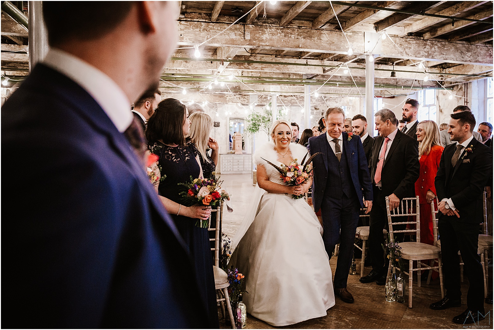 Bride walking down the aisle at Holmes Mill