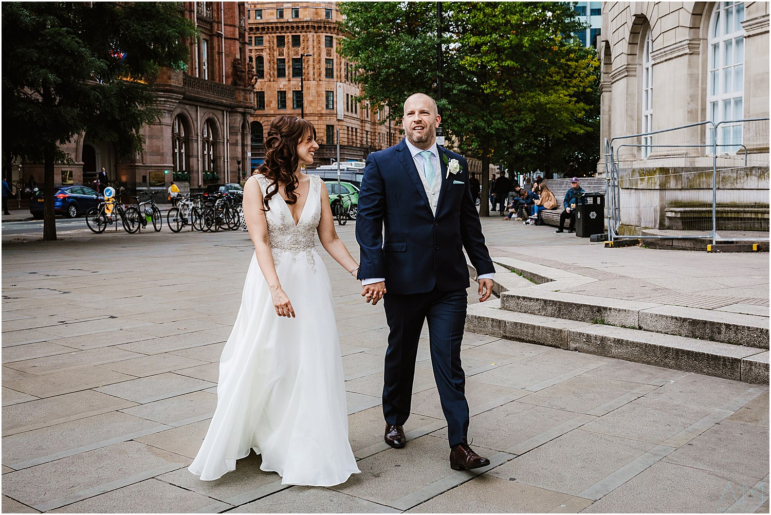 Bride and groom walking in Manchester