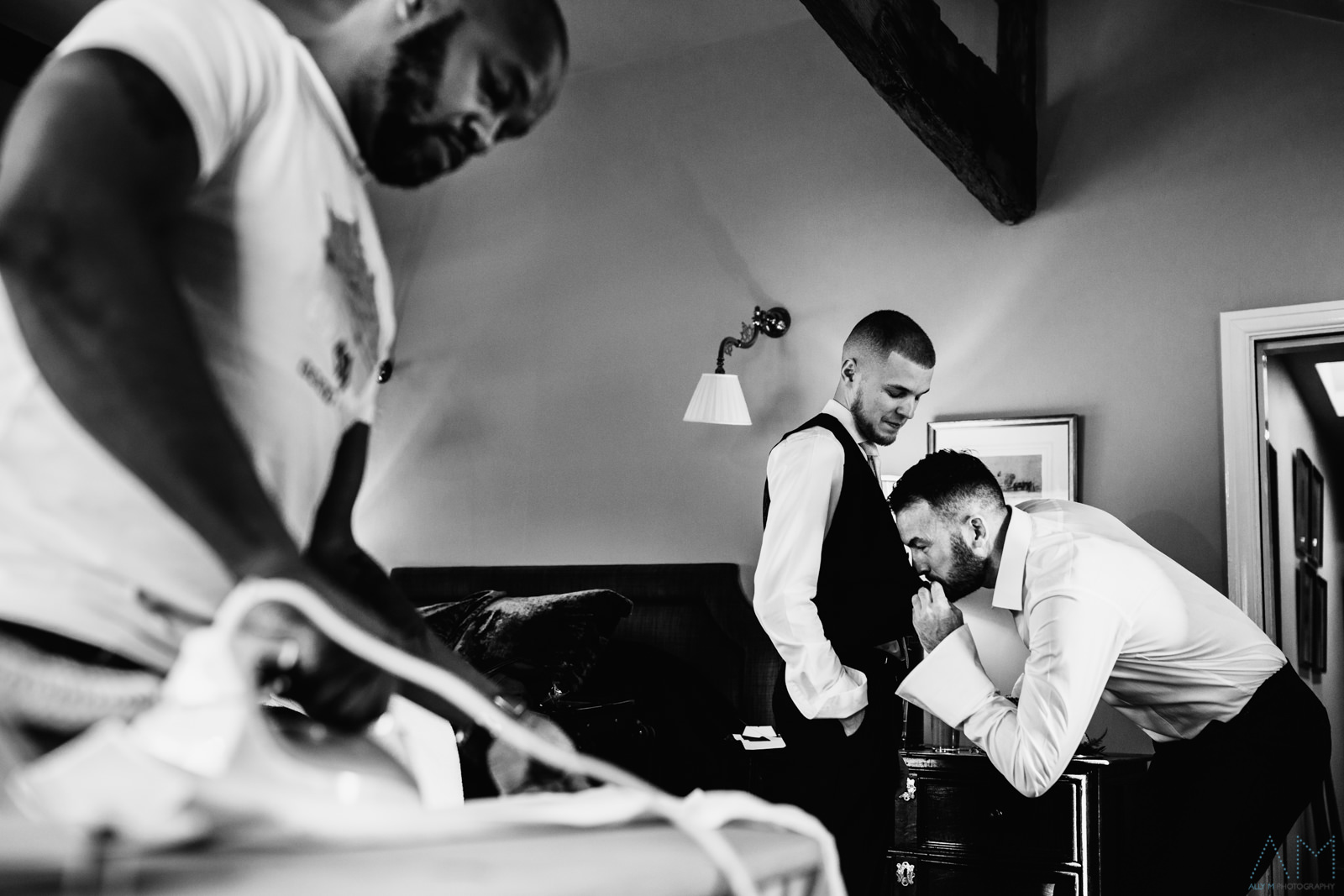 Groom fixing his sons suit