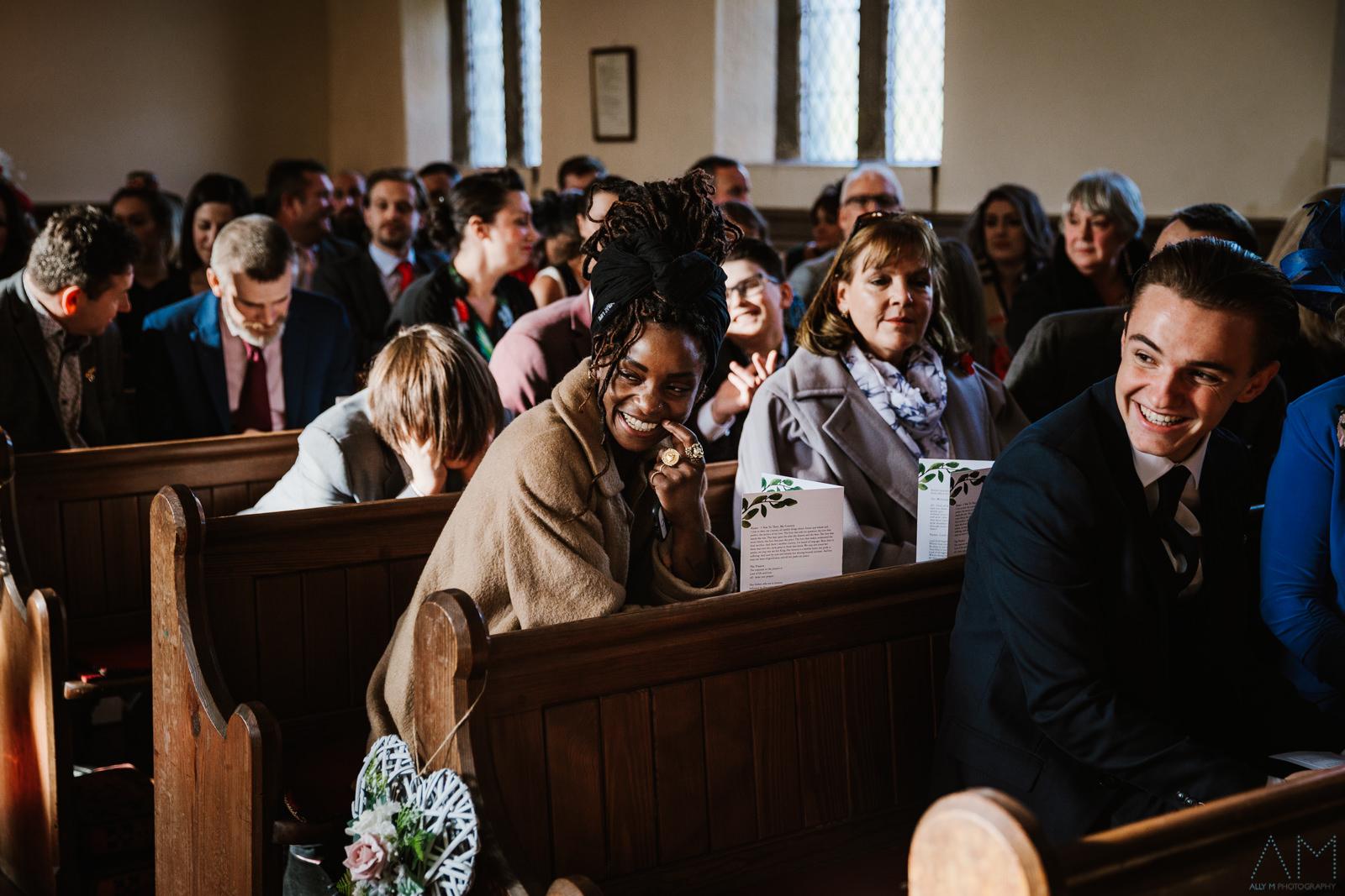 Wedding guest sat in church