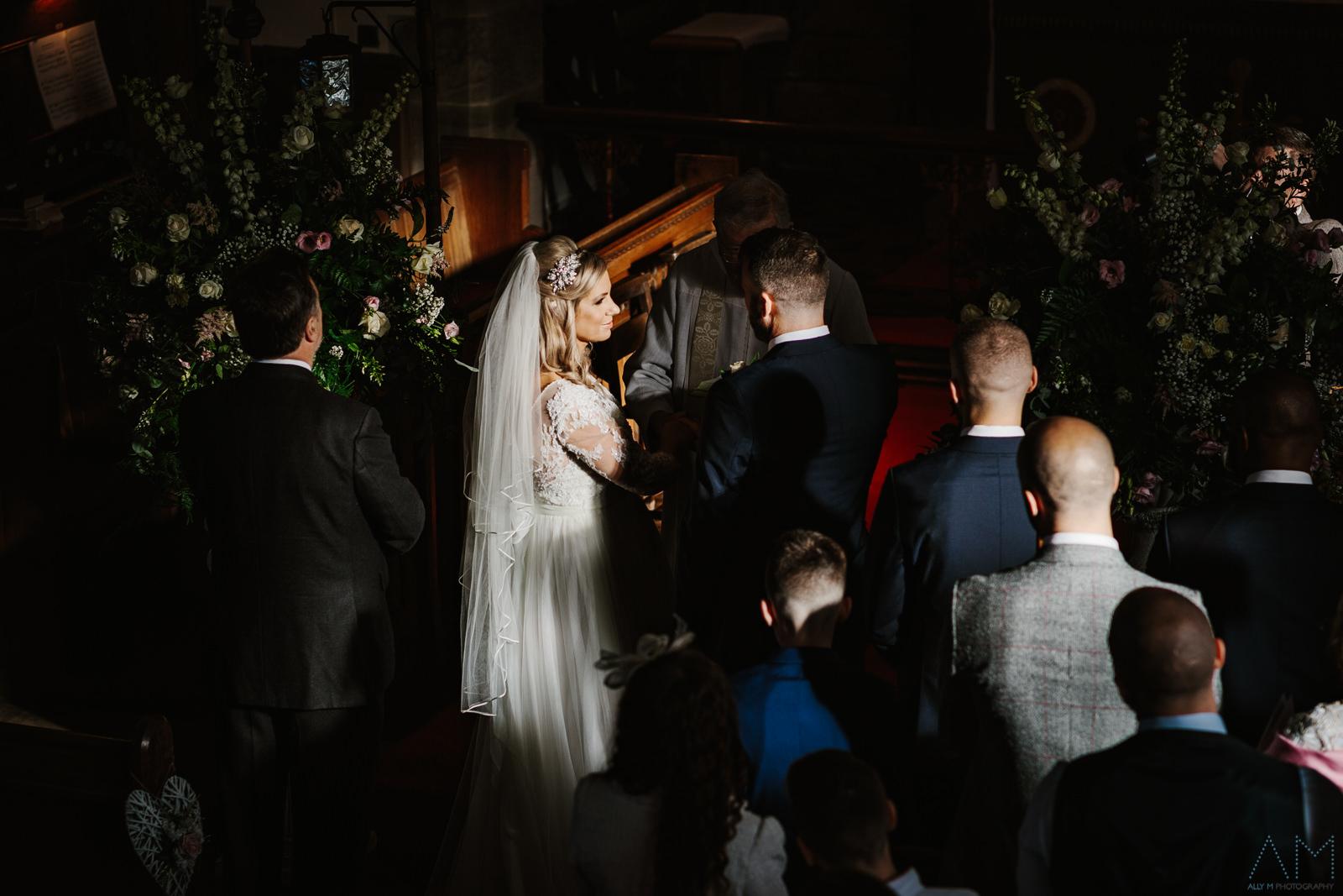 Bride and groom stood in lovely light