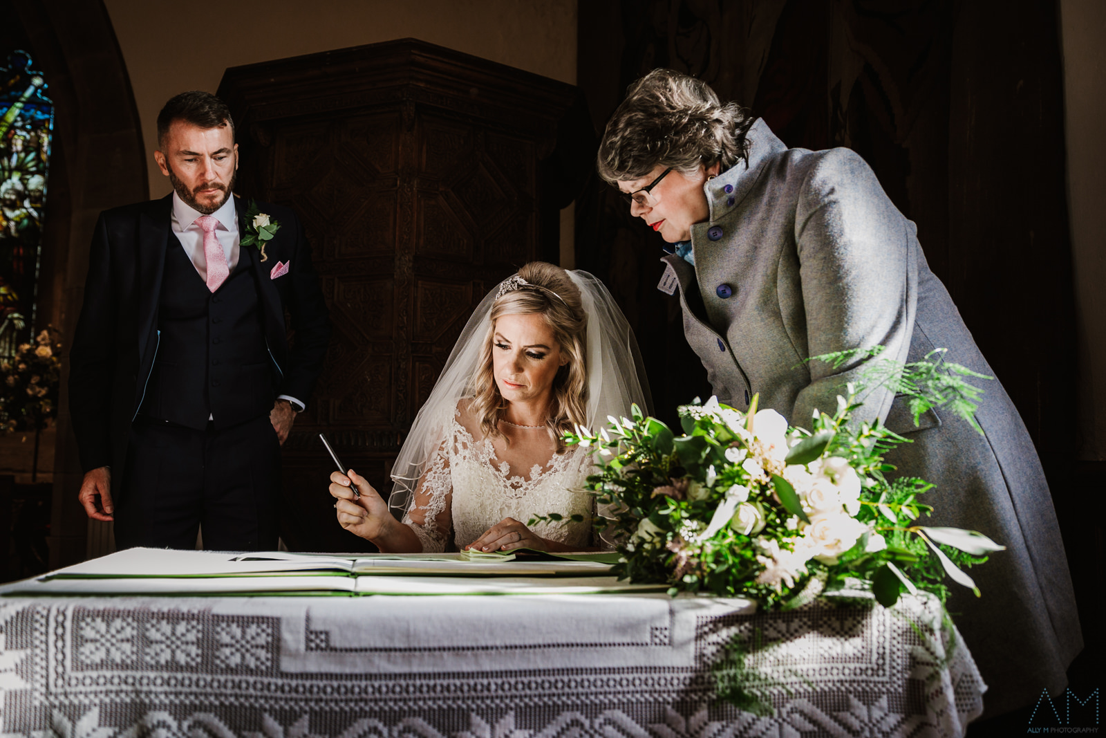 Siging the wedding certificate at the inn at whitewell