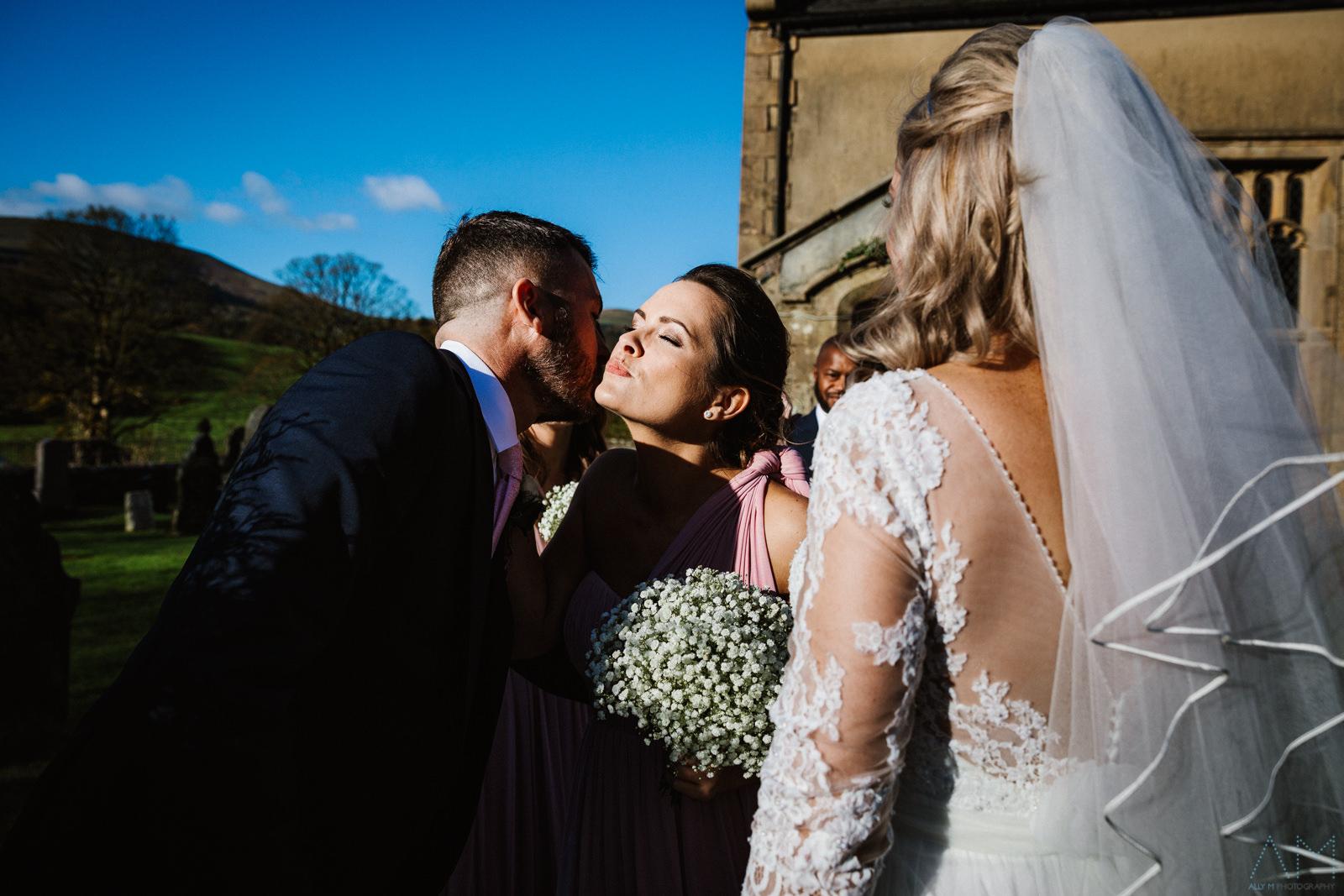 Bridesmaid congratulating the groom.