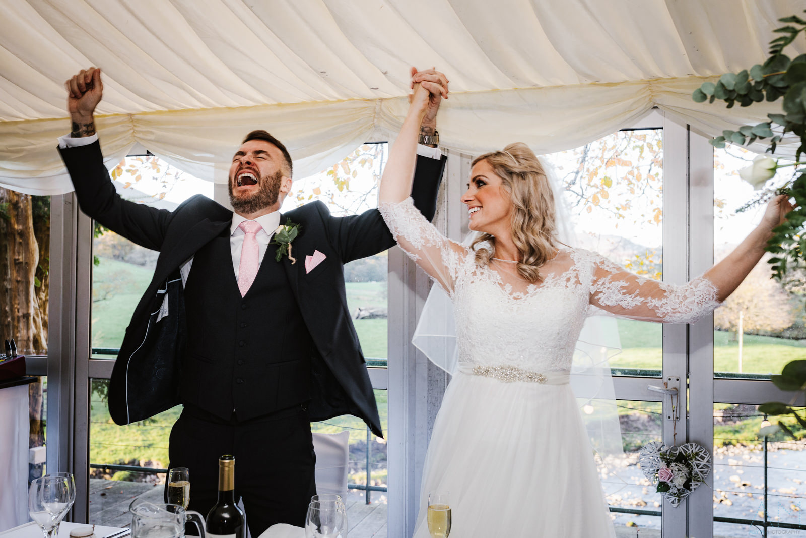 Bride and groom having fun at the inn at whitewell