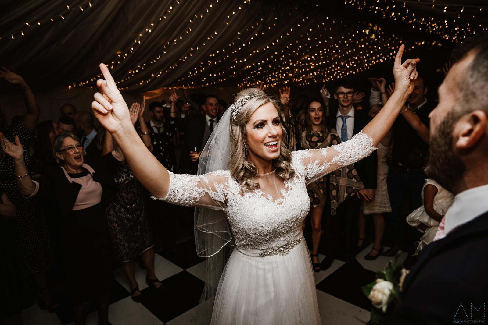 Bride dancing wih her groom