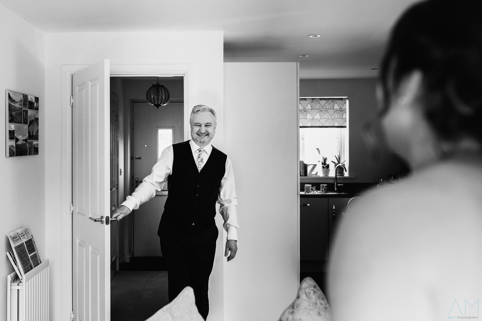 Father of the bride seeing his daugheter in her wedding dress for the first time.