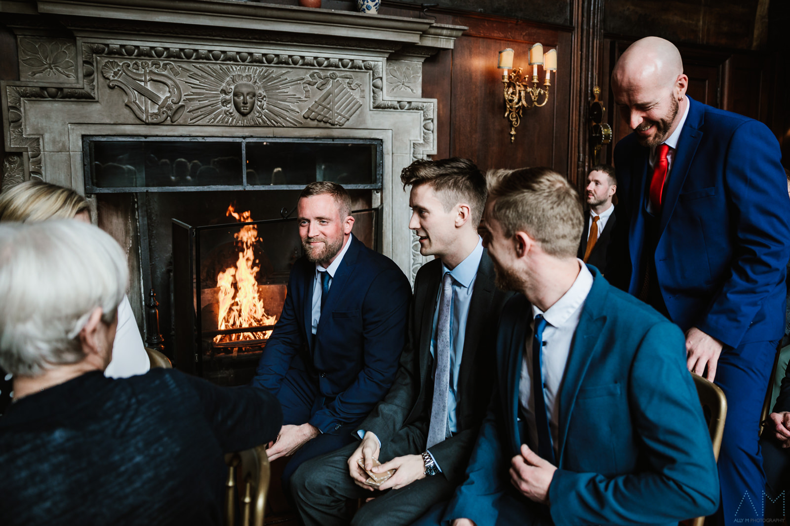 Wedding guests chatting by the fire