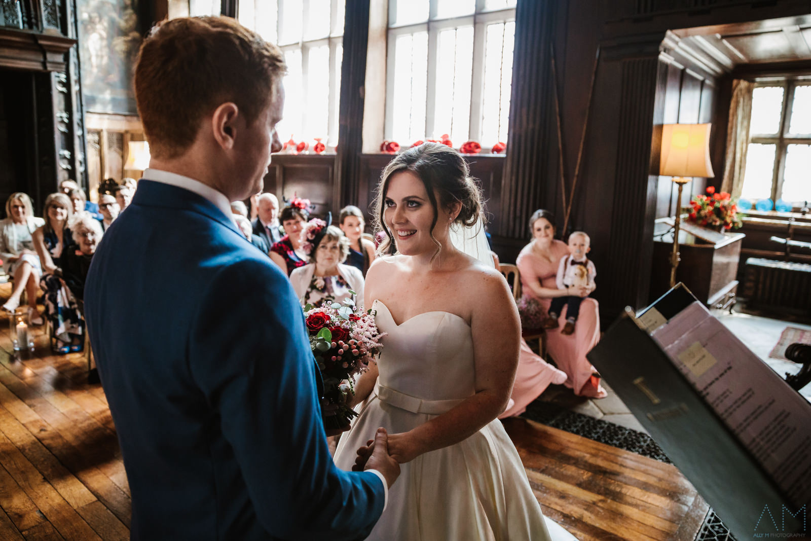 Bride and groom during the ceremony at Adlington Hall
