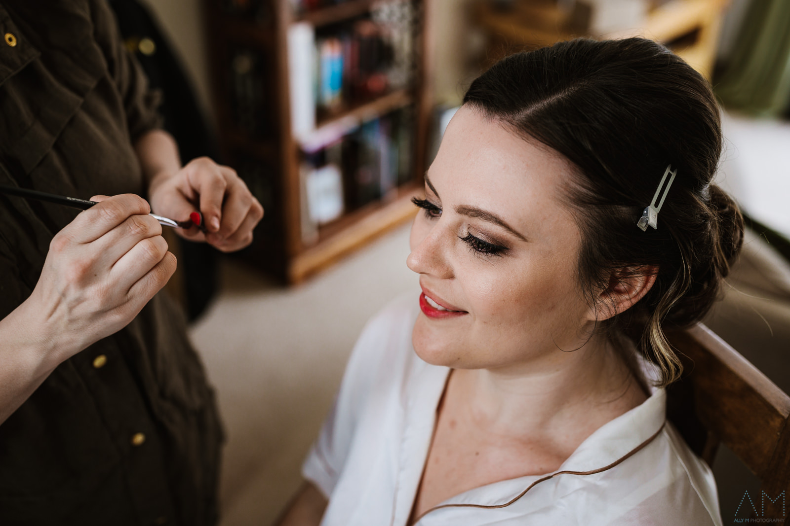 Bride having her makeup done in Cheshire