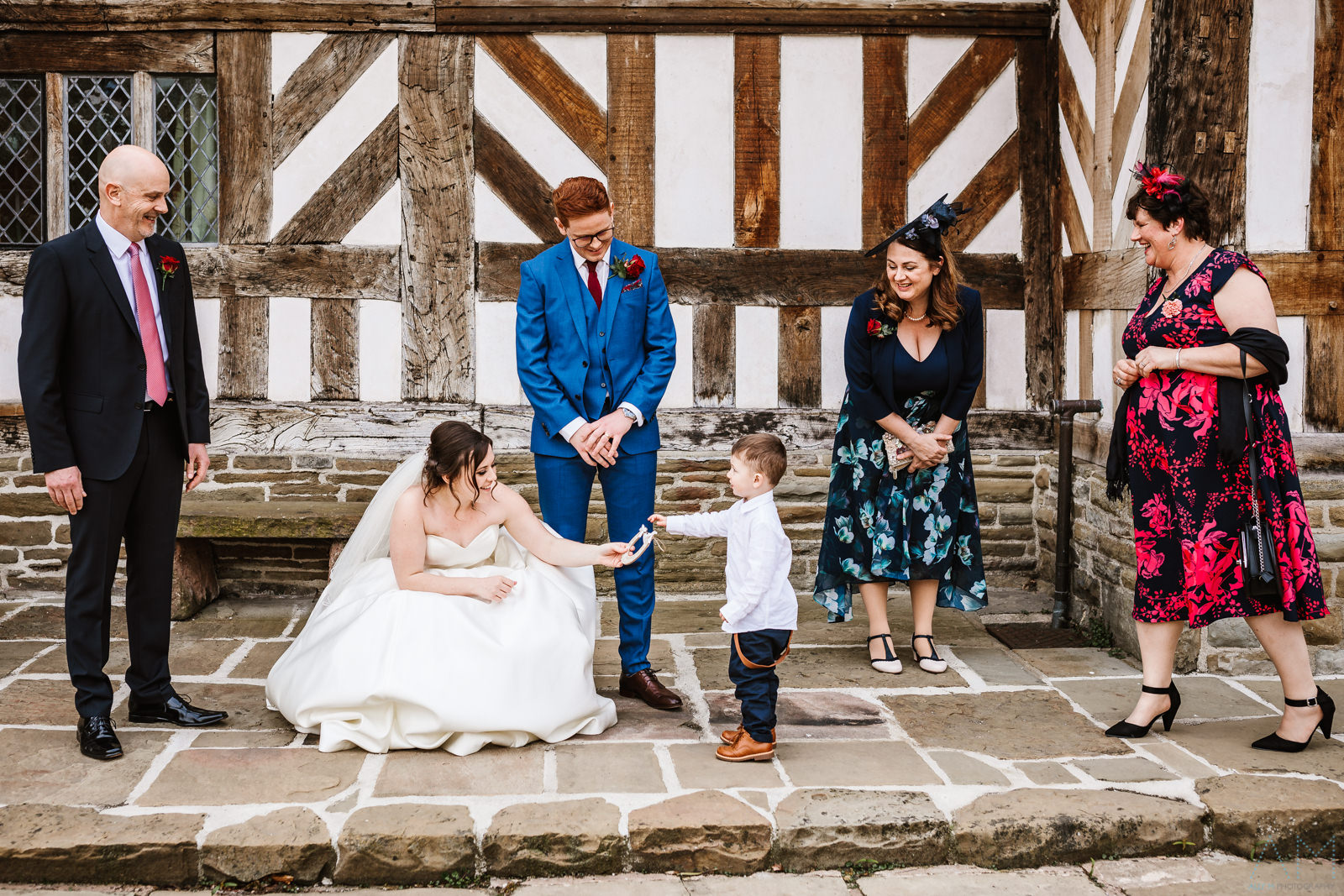 Little boy passes the bride a good luck charm