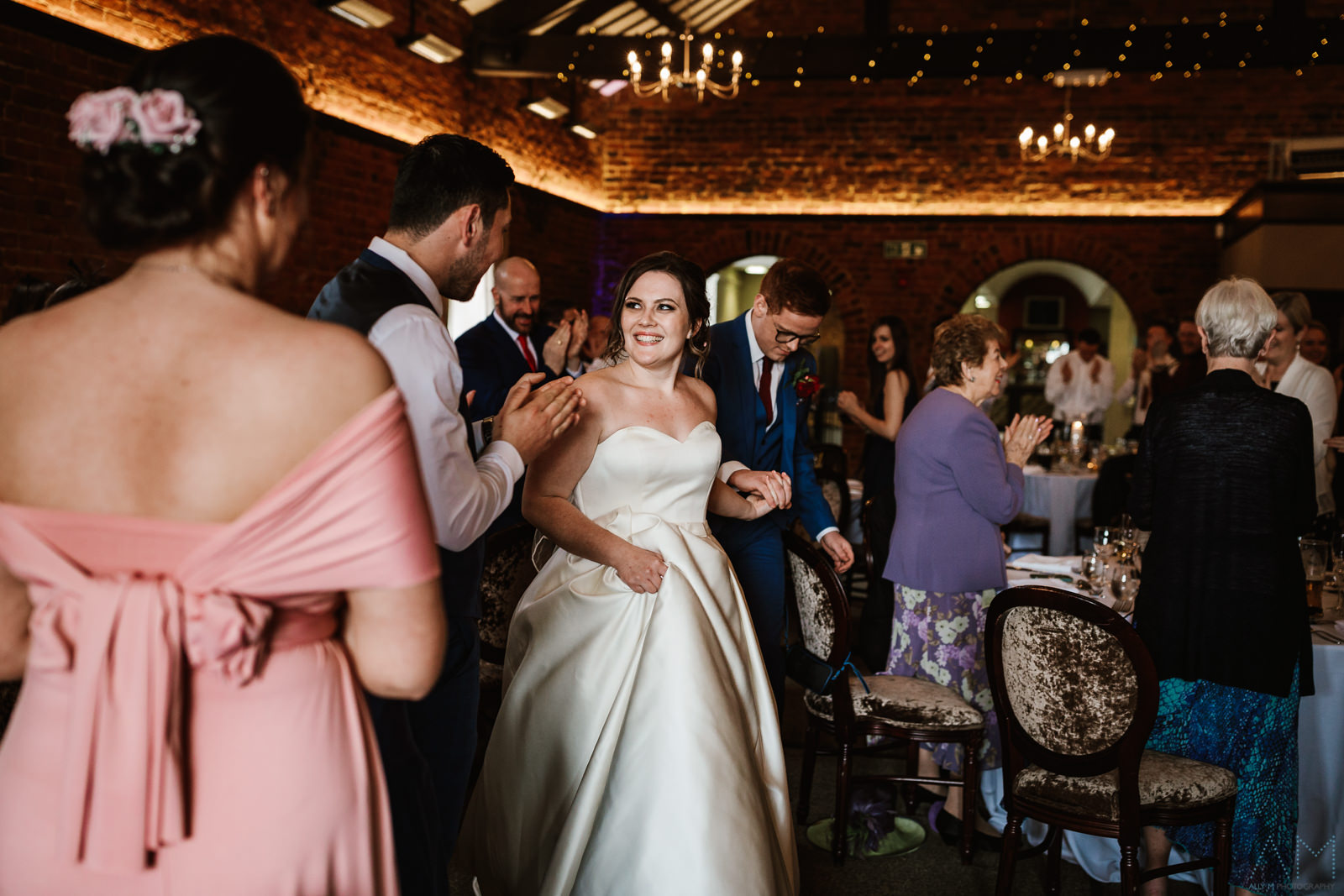 Bride and groom enter The Hunting Lodge