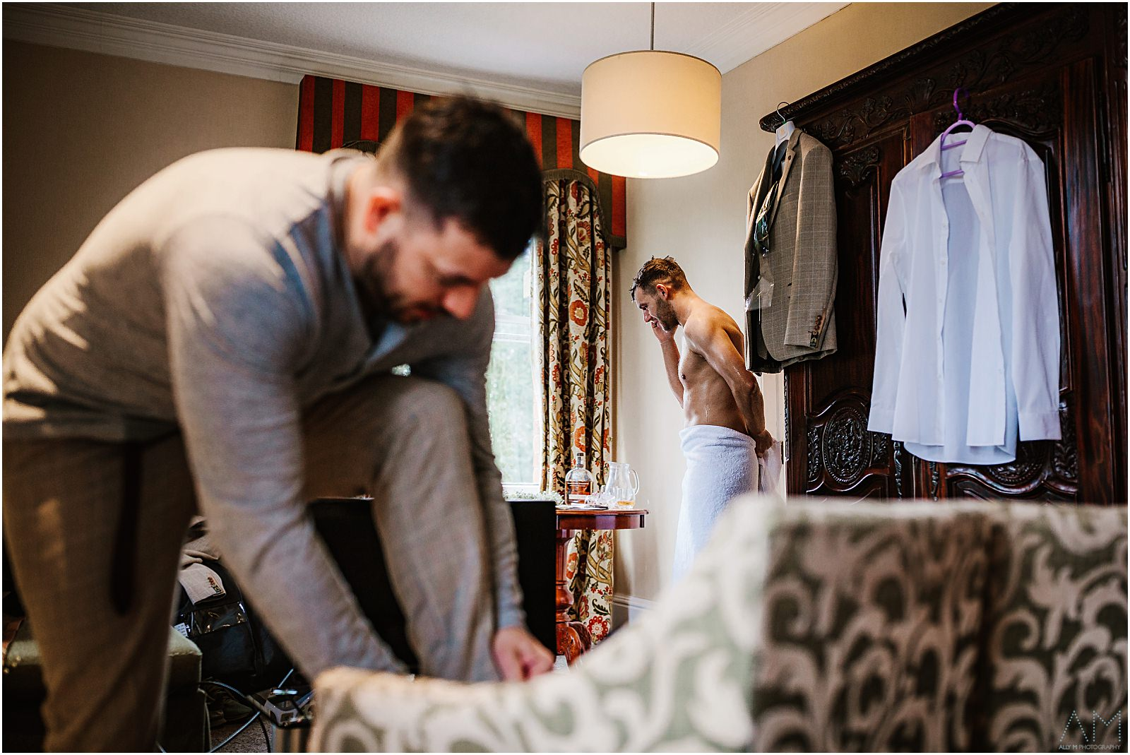 Groom and best man getting ready at Bartle Hall