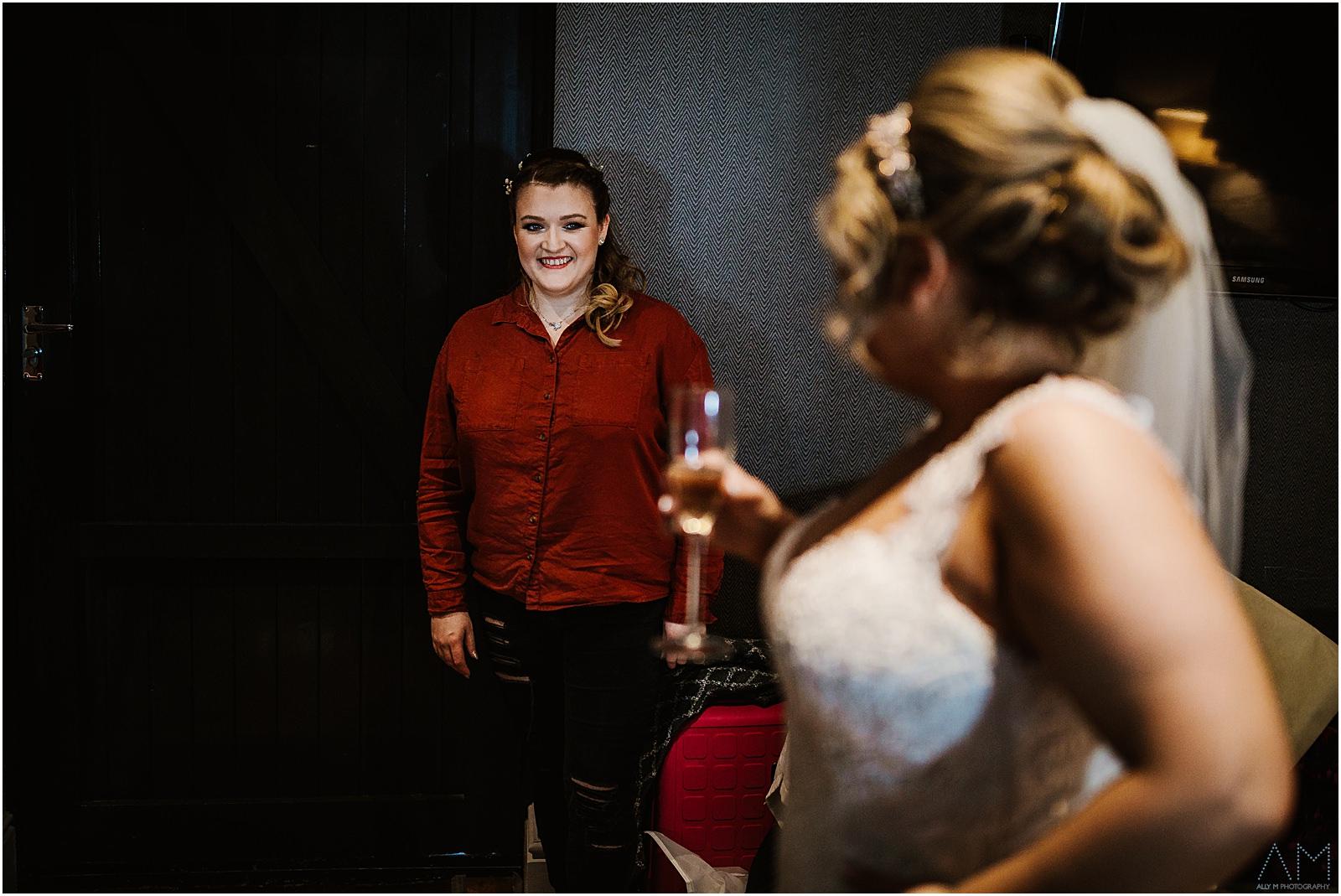 Brides friend smiling