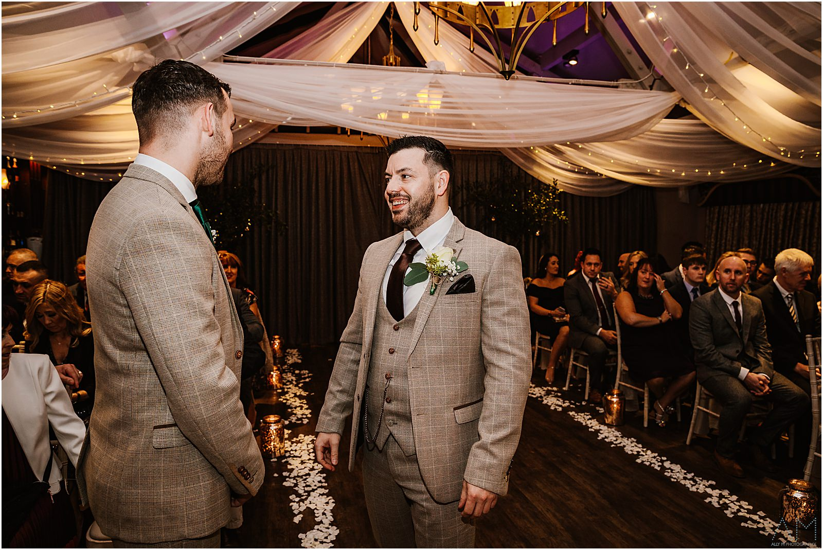 Groom smiling with his best man