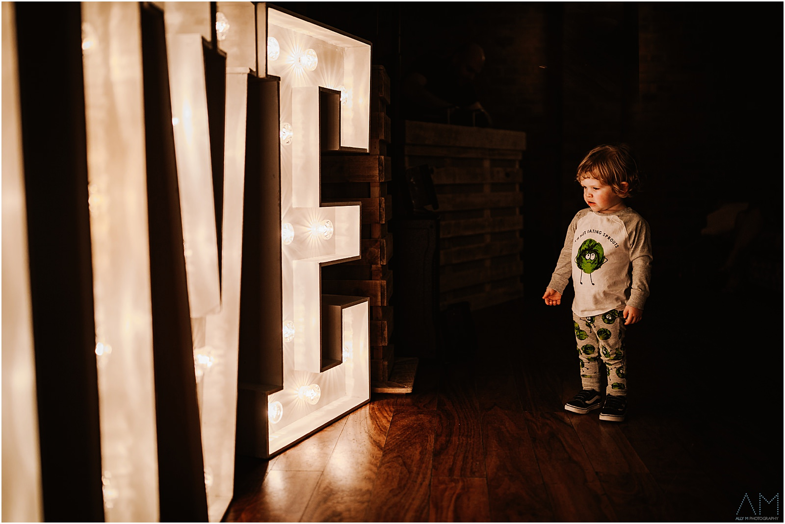 Little boy stood with love letters