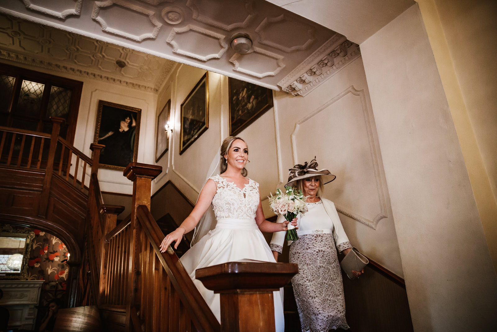 Bride and her mother walking down the Nunsmere Hall stairs