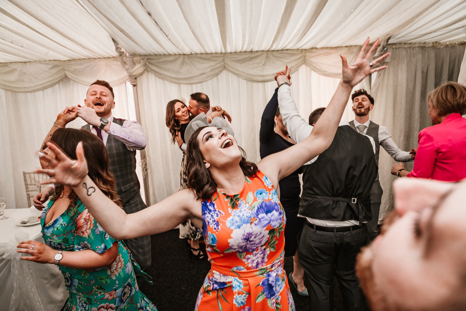 Wedding guests having fun at Nunsmere Hall