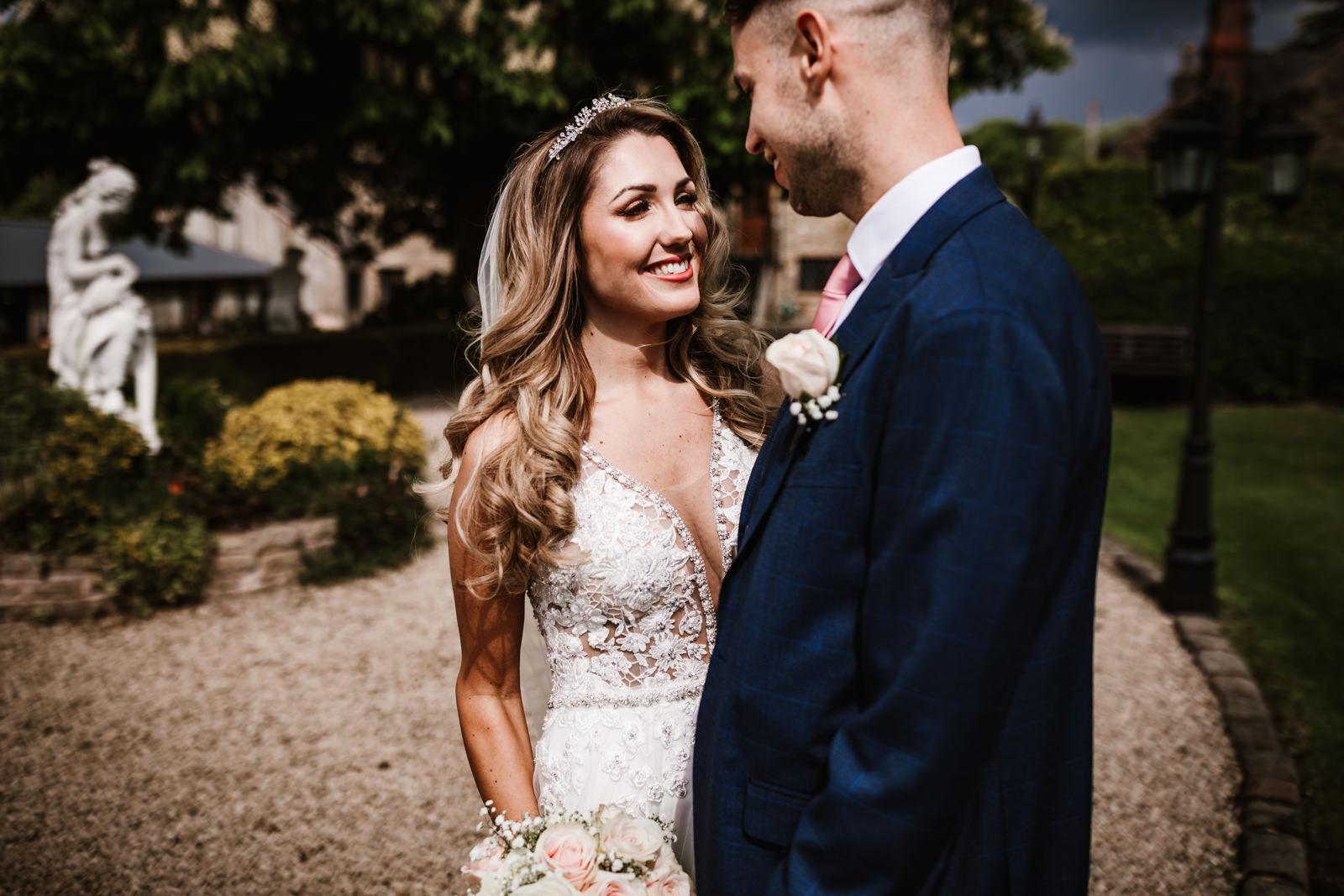Happy bride sming at her groom