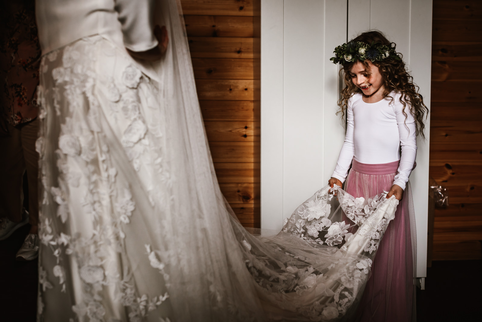 Little girl holding her mummys wedding dress