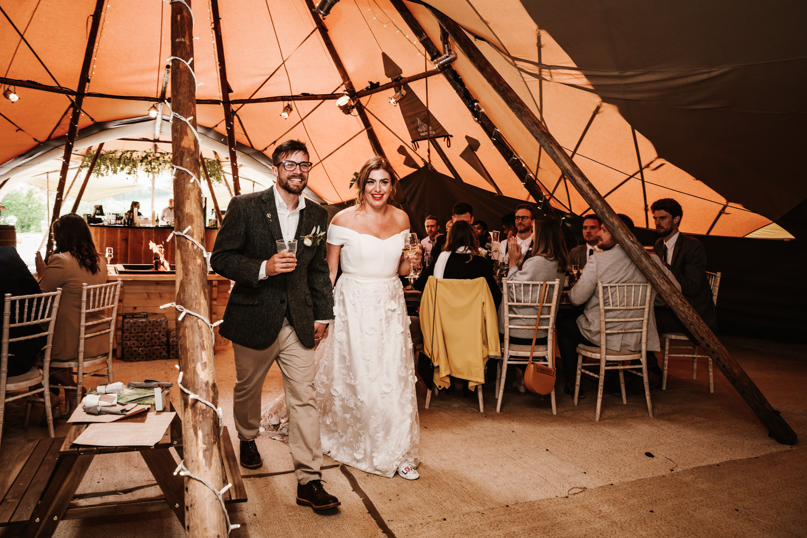 Bride and groom enter the tipi