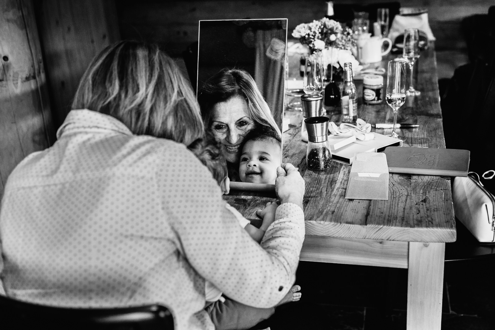 Little girl and grandma looking in the mirror
