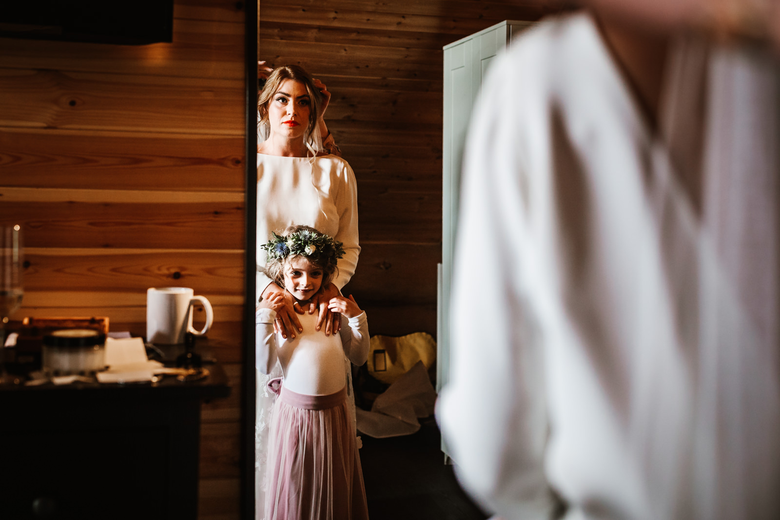 Bride and her daughter looking in the mirror