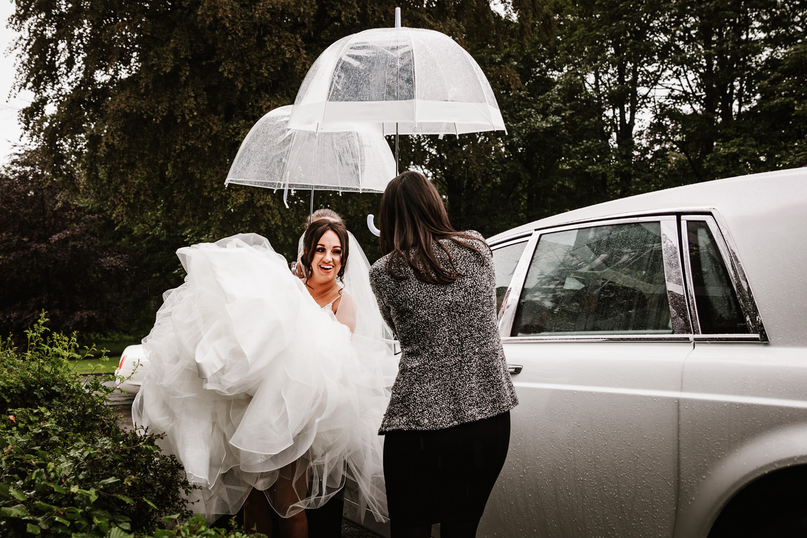 Keeping the bride dry at Rivington hall barn