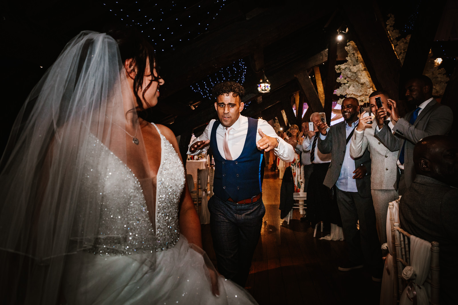 Groom dancing as he enters the room