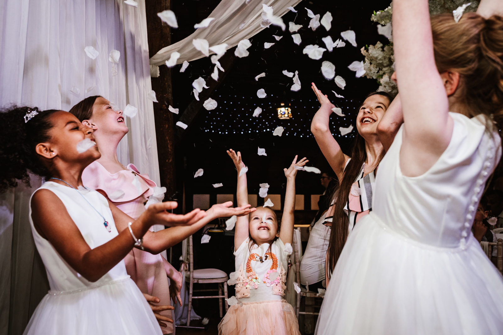 Girls throwing confetti