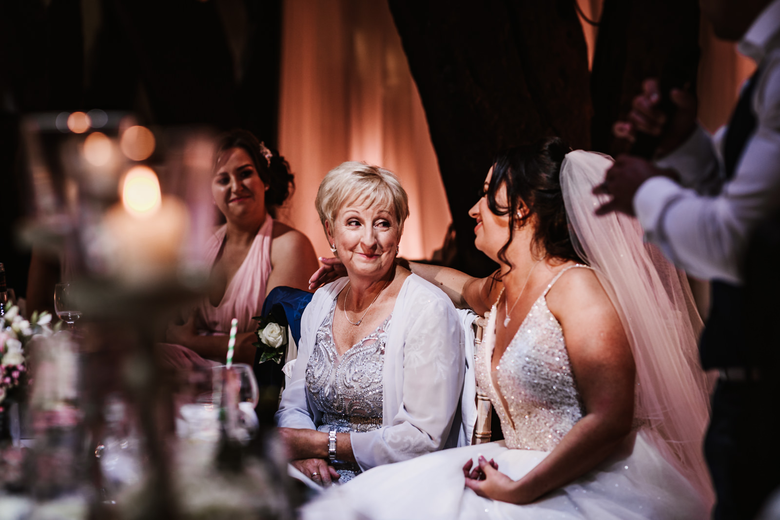 Bride and her mother share a look of love