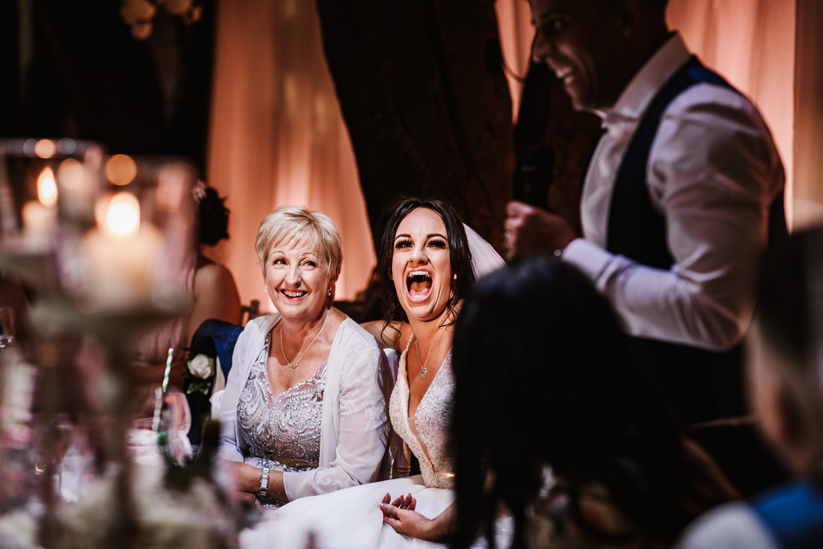 Bride laughing during the groom speech