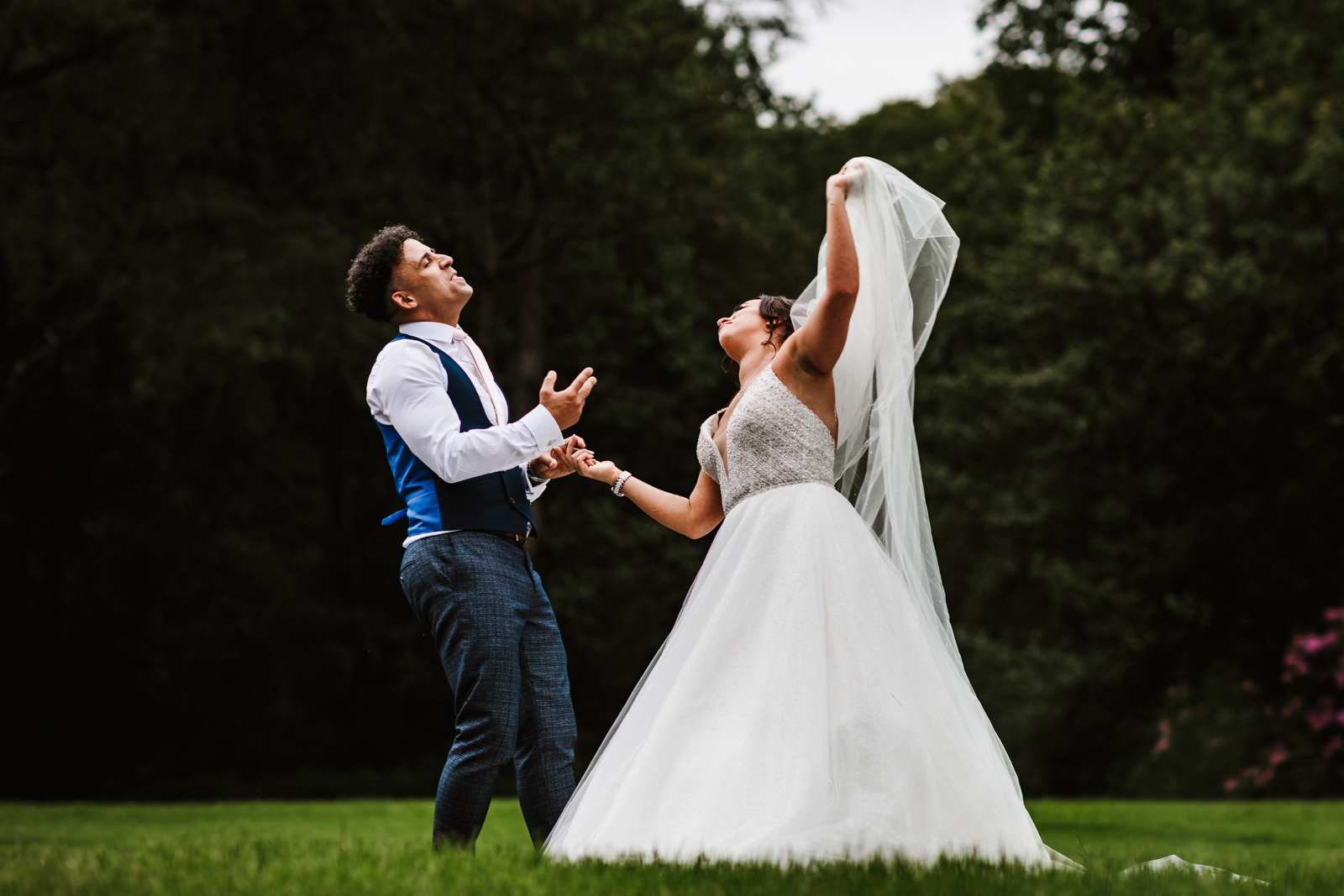 Bride and groom dancing on the lawn