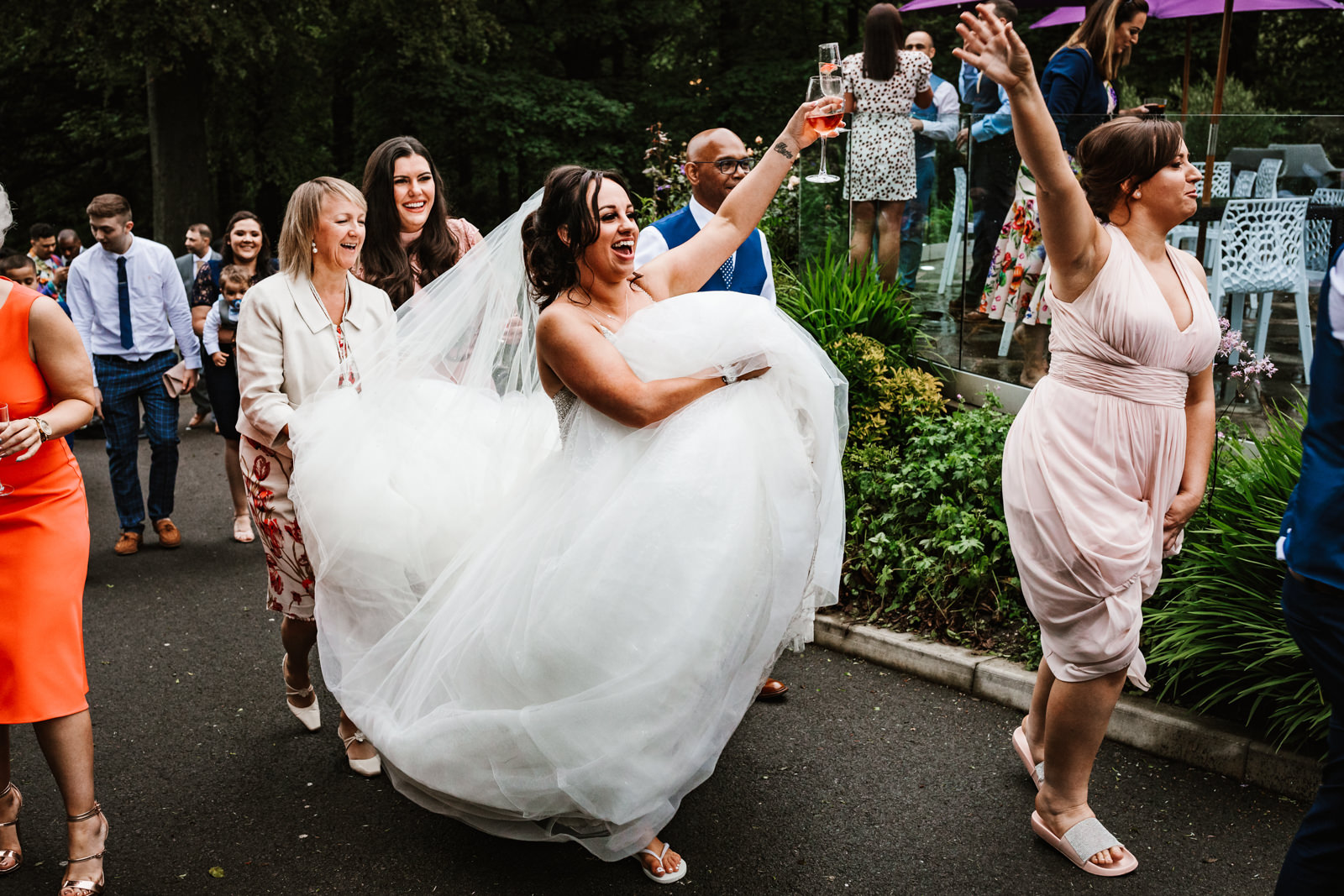 Bride walking back into the venue with her squad