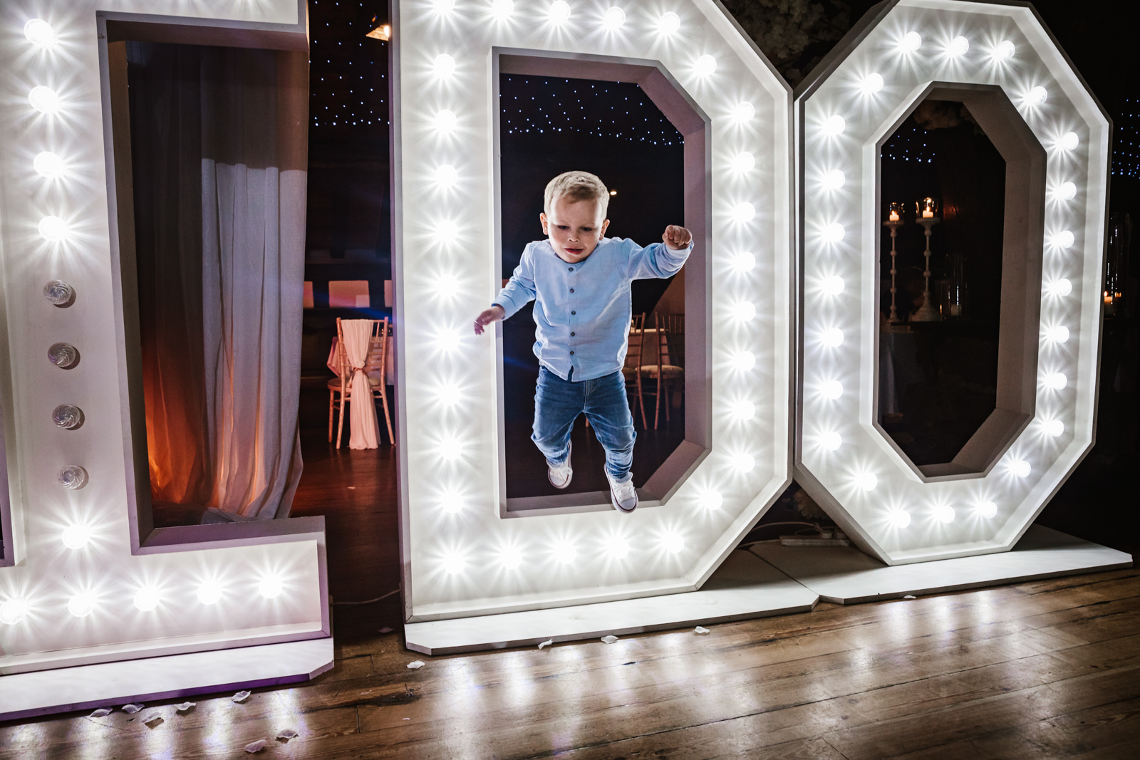 Kid jumping out of the I Do sign