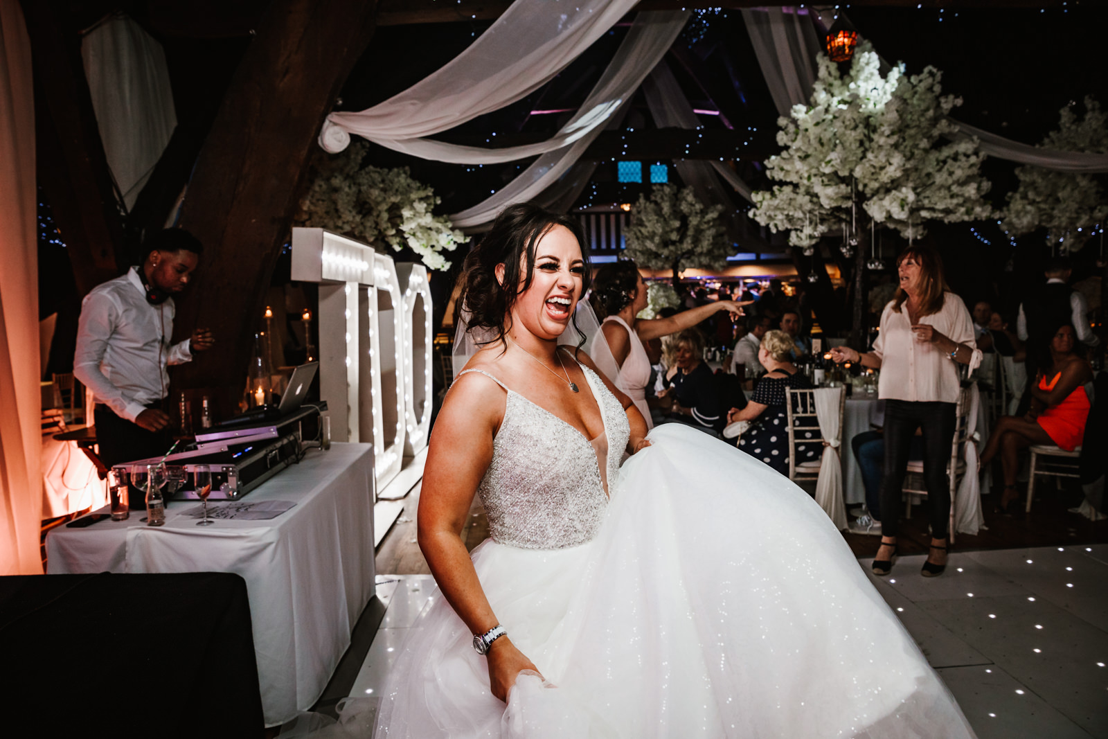 Bride dancing at rivington hall barn