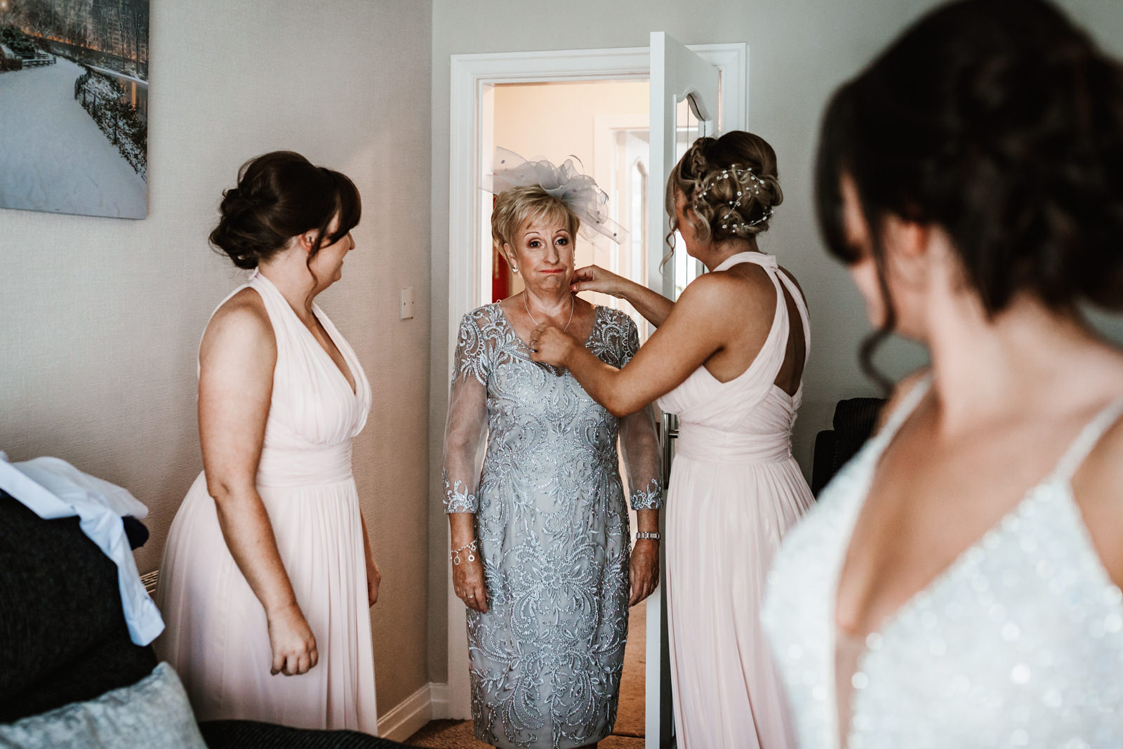 Mother of the bride looks at her girl in her wedding dress