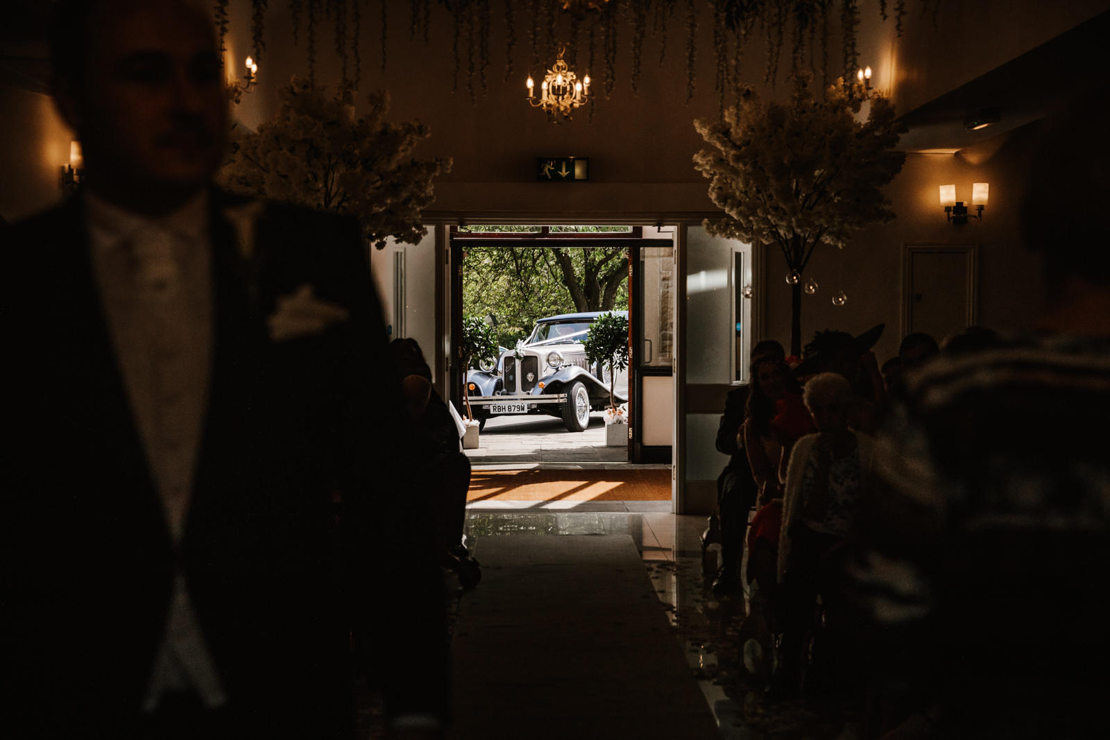 Wedding car arrives at the venue