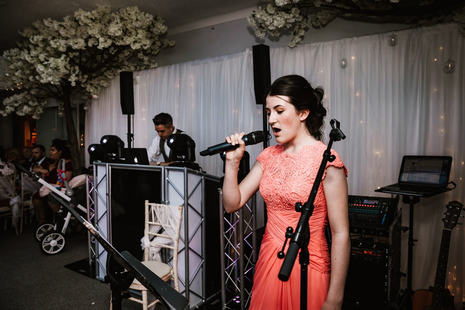 Bridesmaid singing a song during wedding reception