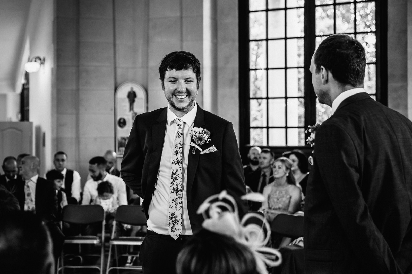 Groom stood smiling waiting for his bride to be